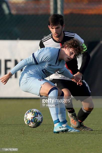 Rodrigo Riquelme of Atletico Madrid U19 and Matteo Anzolin of Juventus Turin U19 battle for the ball during the UEFA Youth League match between...