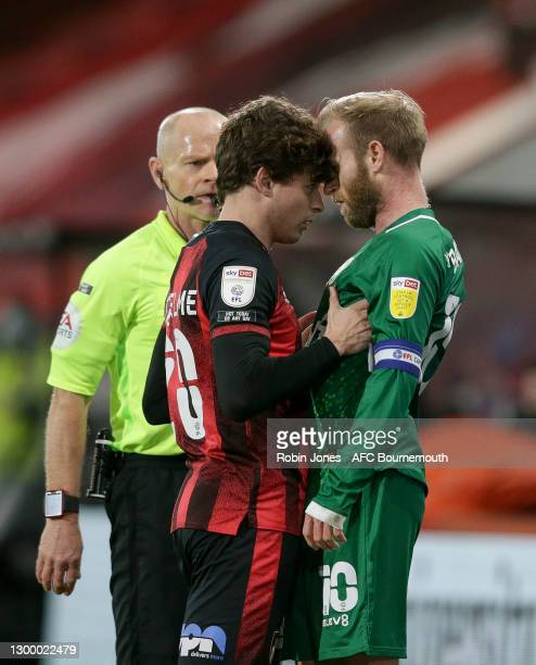 Rodrigo Riquelme of Bournemouth and Barry Bannan of Sheffield Wednesday square up to each other during the Sky Bet Championship match between AFC...