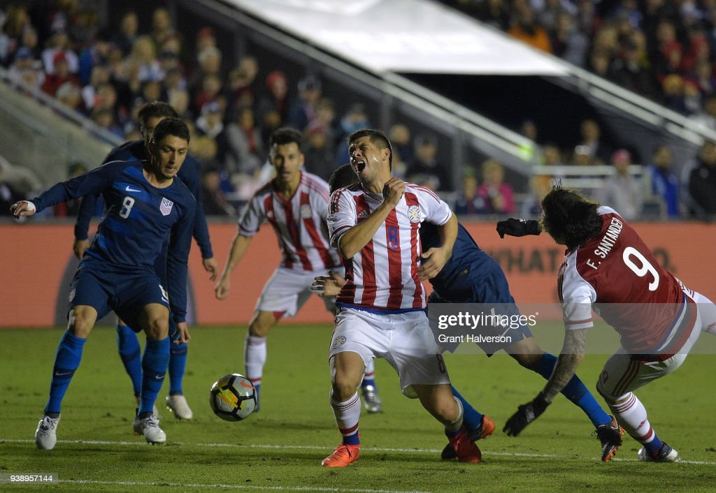 Rodrigo Rojas #8 of Paraguay screams as he collides with Tyler Adams #4 of United States during their game at WakeMed Soccer Park on March 27, 2018 in Cary, North Carolina. The United States won 1-0.