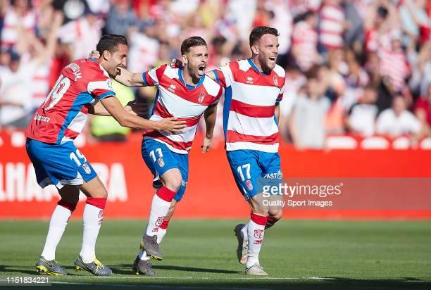 Rodrigo Ríos of Granada CF celebrates scoring his team's opening goal with team mates during the La Liga 123 match between Granada CF and Cadiz CF at...