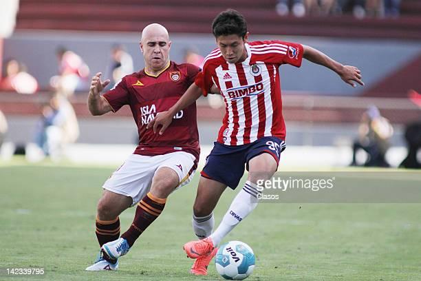 Rodrigo Ruiz of Estudiantes and Giovani Casillas of Chivas struggles for the ball during a match between Estudiantes v Chivas as part of Clausura...