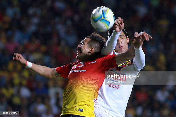 Rodrigo Salinas of Morelia struggles for the ball with Raul Jimenez of America during the Clausura 2013 Liga MX at Morelos Stadium on march 08 2013...