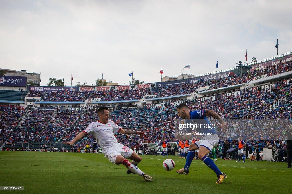 Rodrigo Salinas (L) of Toluca struggle for the ball against Edgar Mendez (R) of Cruz Azul during the 4th round match between Cruz Azul and Chivas as part of the Torneo Apertura 2017 Liga MX at Azul Stadium on August 12, 2017 in Mexico City, Mexico.