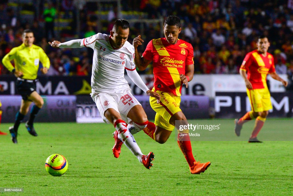 Rodrigo Salinas (L) of Toluca tries to dribble Ray Sandoval (R) of Morelia during the 15th round match between Morelia and Toluca as part of the Torneo Clausura 2018 Liga MX at Jose Maria Morelos Stadium on April 14, 2018 in Morelia, Mexico.