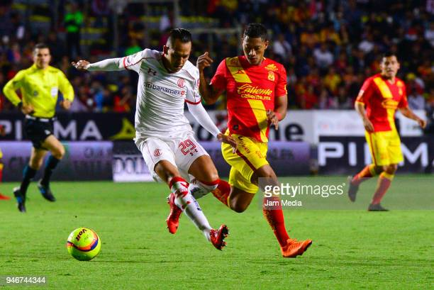 Rodrigo Salinas of Toluca tries to dribble Ray Sandoval of Morelia during the 15th round match between Morelia and Toluca as part of the Torneo...