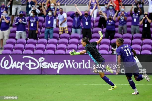 Rodrigo Schlegel of Orlando City SC reacts after making a save during penalty kicks against the New York City FC during Round One of the MLS Cup...
