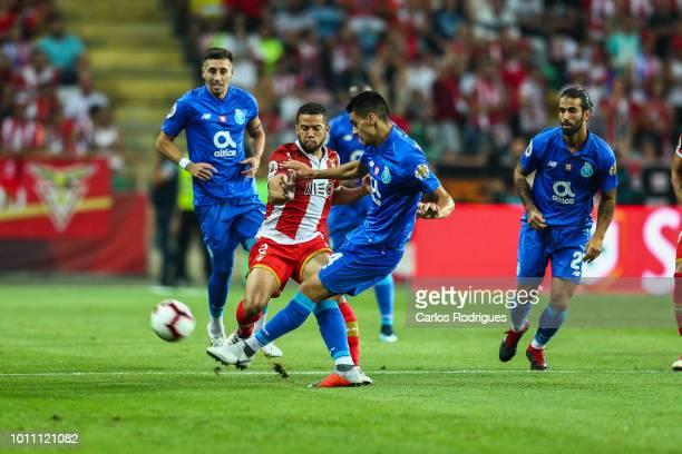 Rodrigo Soares of Desportivo das Aves vies with Diogo Leite of FC Porto for the ball possesion during the match between FC Porto and Desportivo das...