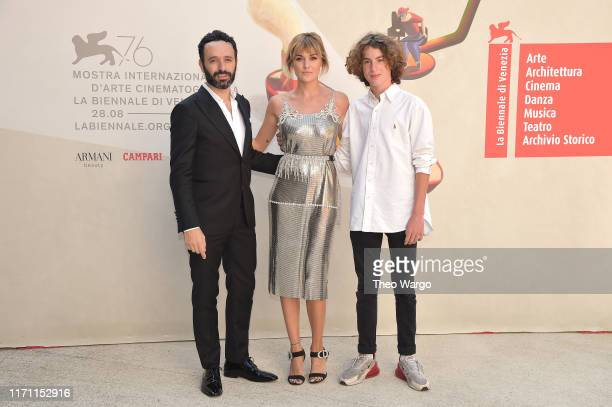 "Rodrigo Sorogoyen, Marta Nieto and Jules Porler walk the red carpet ahead of the ""Madre"" screening during the 76th Venice Film Festival at Sala..."