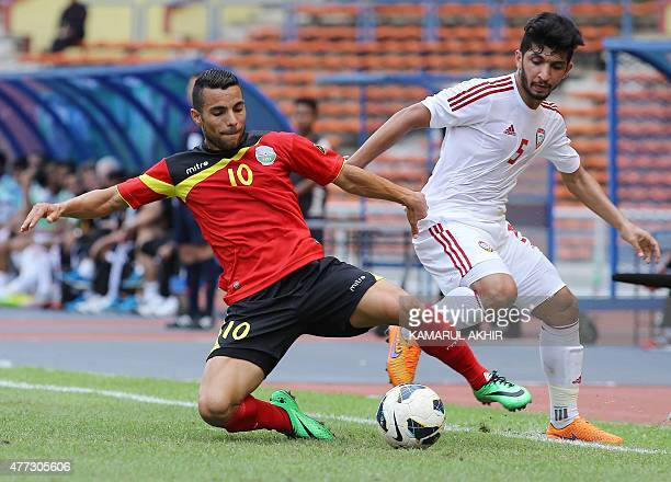 Rodrigo Sousa of East Timor and Amer Abdulrahman of UAE fight for the ball during the 2018 FIFA World Cup football qualifying match between East...