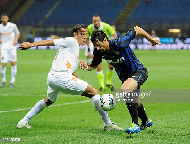 Rodrigo Taddei of AS Roma and Diego Milito of FC Inter Milan battle for the ball during the Serie A match between FC Internazionale Milano and AS...