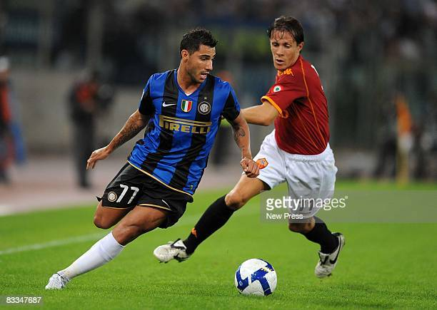 Rodrigo Taddei of Roma chases down Ricardo Quaresma in action during the Serie A match between Roma and Inter at the Stadio Olimpico on October 19...