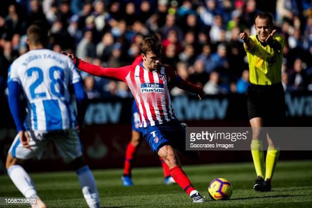 Rodrigo Tarin of Leganes Antoine Griezmann of Atletico Madrid Melero Lopez referee during the La Liga Santander match between Leganes v Atletico...