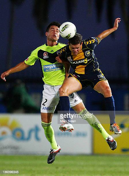 Rodrigo Vargas of the Victory and Troy Hearfield of the Mariners contest possession during the round 13 midweek ALeague match between the Central...