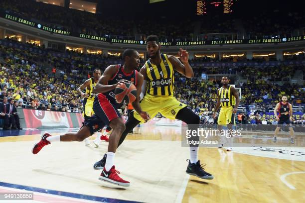 Rodrigue Beaubois #10 of Kirolbet Baskonia Vitoria Gasteiz in action with Jason Thompson #1 of Fenerbahce Dogus during the Turkish Airlines...