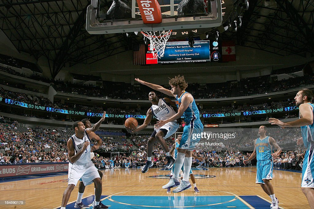 Rodrigue Beaubois #3 of the Dallas Mavericks goes to the basket against Robin Lopez #15 of the New Orleans Hornets during the game between the New Orleans Hornets and the Dallas Mavericks on October 22, 2012 at the American Airlines Center in Dallas, Texas.