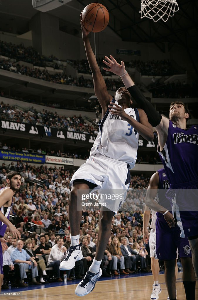 Rodrigue Beaubois #3 of the Dallas Mavericks goes up for the layup against Andres Nocioni #5 of the Sacramento Kings during a game at the American Airlines Center on March 5, 2010 in Dallas, Texas.