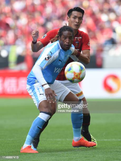 Rodrigues of Jubilo Iwata and Tomoaki Makino Urawa Red Diamonds compete for the ball during the JLeague J1 match between Urawa Red Diamonds and...