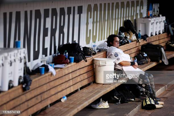 Rodriguez of the Vanderbilt reacts alone in the dugout after being shutout 0-9 against Mississippi St. During game three of the College World Series...