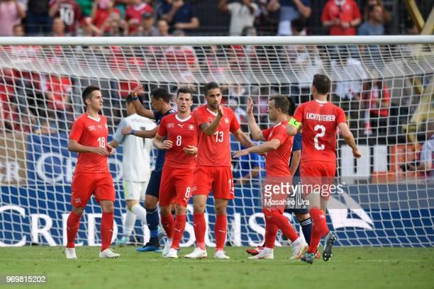 Rodriguez Ricardo of Switzerland celebrates scoring the opening goal with his team mates during the international friendly match between Switzerland...