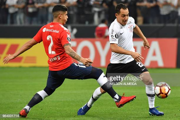 Rodriguinho of Brazil's Corinthians vies for the ball with Alan Franco of Argentina's Independiente during their 2018 Copa Libertadores football...