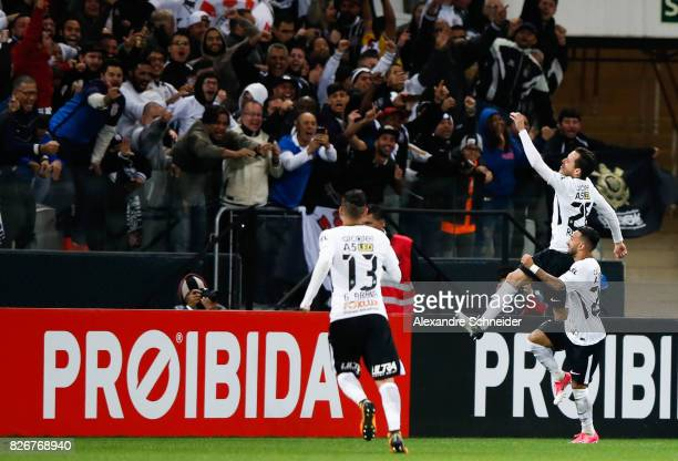 Rodriguinho of Corinthians celebrates with his team mates their second goal during the match between Corinthians and Sport Recife for the Brasileirao...
