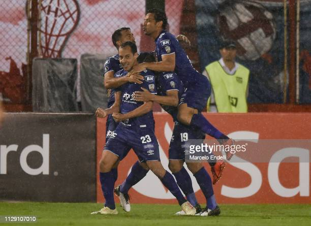 Rodriguinho of Cruzeiro celebrates with teammates after scoring the first goal of his team during a Group B match between Huracan and Cruzeiro as...