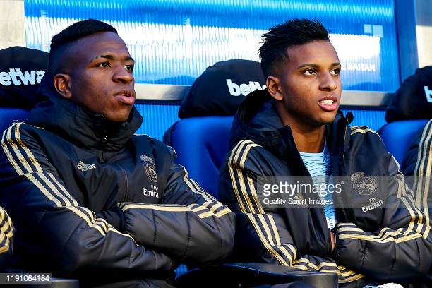 Rodrygo and Vinicius Junior of Real Madrid CF looks on from the bench prior to the Liga match between Deportivo Alaves and Real Madrid CF at Estadio...