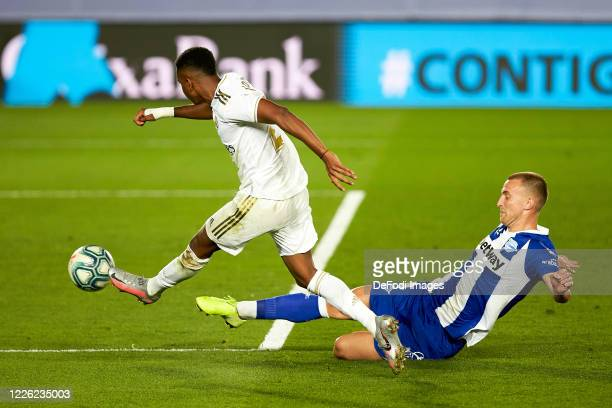Rodrygo Goes of Real Madrid and Rodrigo Ely of Deportivo Alaves battle for the ball during the Liga match between Real Madrid CF and Deportivo Alaves...