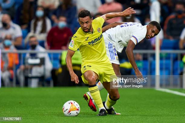 Rodrygo Goes of Real Madrid CF battle for the ball with Francis Coquelin of Villarreal CF during the La Liga Santander match between Real Madrid CF...
