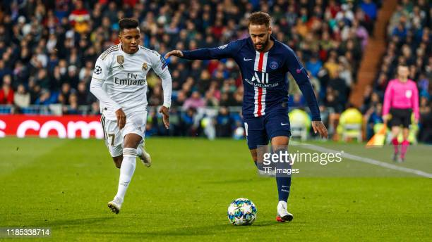 Rodrygo Goes of Real Madrid Neymar of Paris Saint Germain battle for the ball during the UEFA Champions League group A match between Real Madrid and...