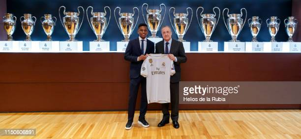Rodrygo Goes of Real Madrid poses with president Florentino Perez during his official presentation at Estadio Santiago Bernabeu on June 17 2019 in...