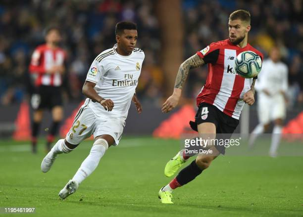 Rodrygo of Real Madrid battles for possession with Inigo Martinez of Athletic Club during the Liga match between Real Madrid CF and Athletic Club at...