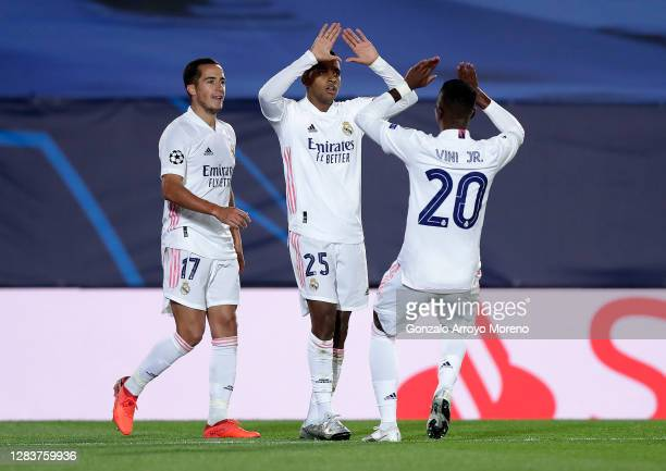 Rodrygo of Real Madrid celebrates after scoring his sides third goal with Vinicius Junior and Lucas Vazquez of Real Madrid during the UEFA Champions...
