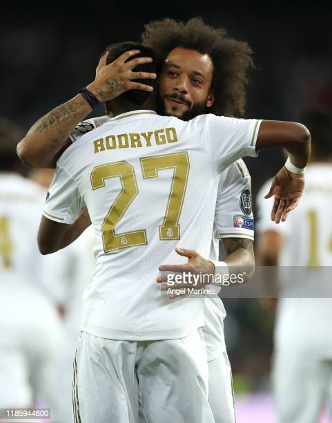 Rodrygo of Real Madrid celebrates with Marcelo after scoring his team's first goal during the UEFA Champions League group A match between Real Madrid...