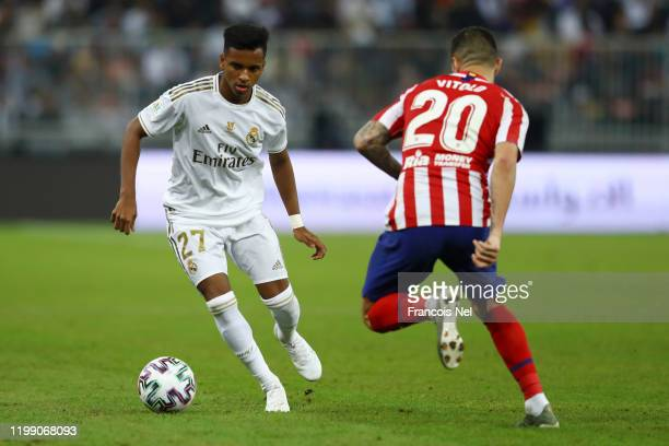 Rodrygo of Real Madrid controls the ball as Vitolo of Atletico Madrid looks on during the Supercopa de Espana Final match between Real Madrid and...
