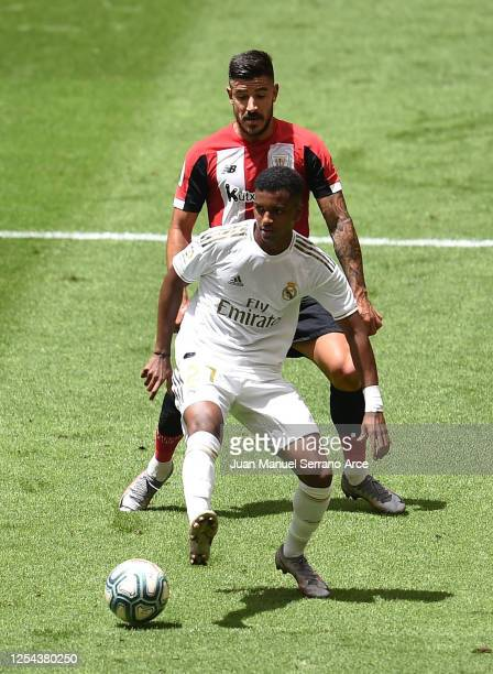 Rodrygo of Real Madrid is challenged by Yuri Berchiche of Athletic Club during the La Liga match between Athletic Club and Real Madrid CF at San...