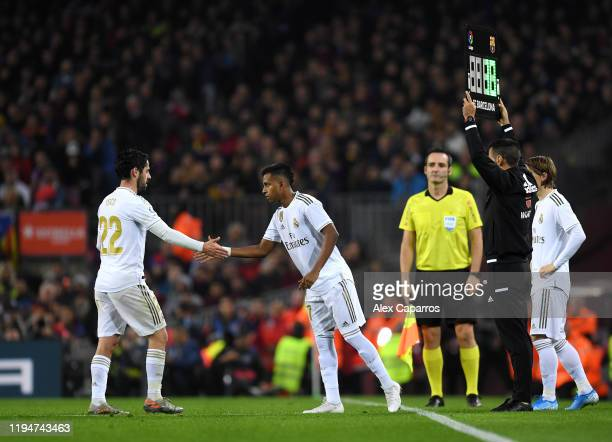 Rodrygo of Real Madrid replaces Francisco Alarcon 'Isco' of Real Madrid during the Liga match between FC Barcelona and Real Madrid CF at Camp Nou on...