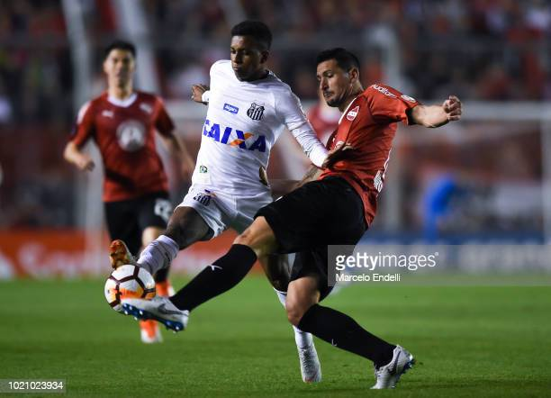 Rodrygo of Santos fights for the ball with Guillermo Burdisso of Independiente during a round of sixteen match between Independiente and Santos as...