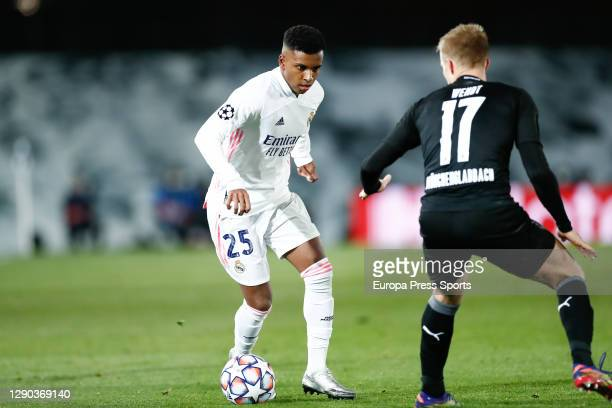 Rodrygo Silva de Goes of Real Madrid and Oscar Wendt of Monchengladbach in action during the UEFA Champions League Group B stage match between Real...