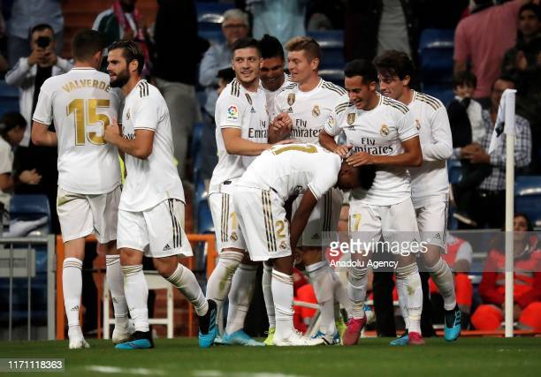 Rodrygo Silva de Goes of Real Madrid celebrates his goal with his team mates during the La Liga match between Real Madrid and Osasuna at the Santiago...
