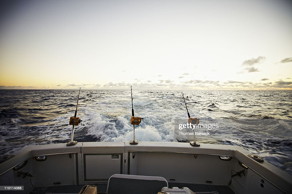 Rods and reels on board of sport fishing boat : Stock Photo