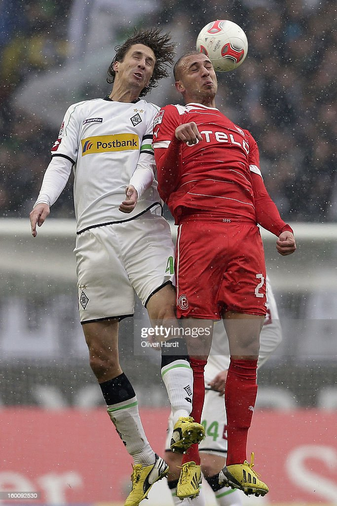 Roel Brouwers (L) of Gladbach and Dani Schahin (R) of Duesseldorf battle for the ball during at Bundesliga match between VfL Borussia Moenchengladbach v Fortuna Duesseldorf at Borussia Park Stadium on January 26, 2013 in Moenchengladbach, Germany.