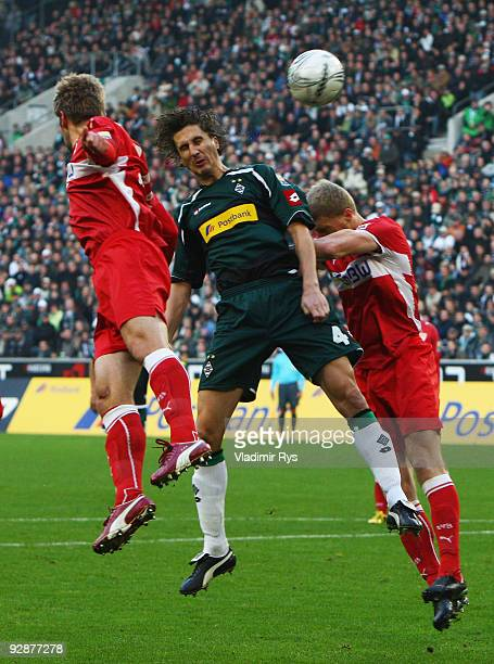 Roel Brouwers of Gladbach, Thomas Hitzlsperger and his team mate Pavel Pogrebnyak of Stuttgart vie for a header during the Bundesliga match between...