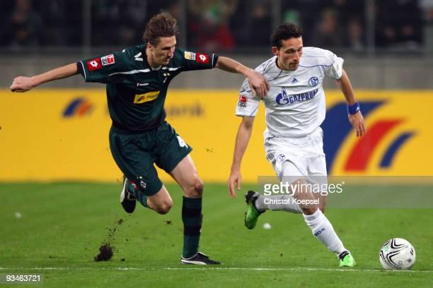 Roel Brouwers of Moenchengladbach challenges Kevin Kuranyi of Schalke during the Bundesliga match between Borussia Moenchengladbach and FC Schalke 04...
