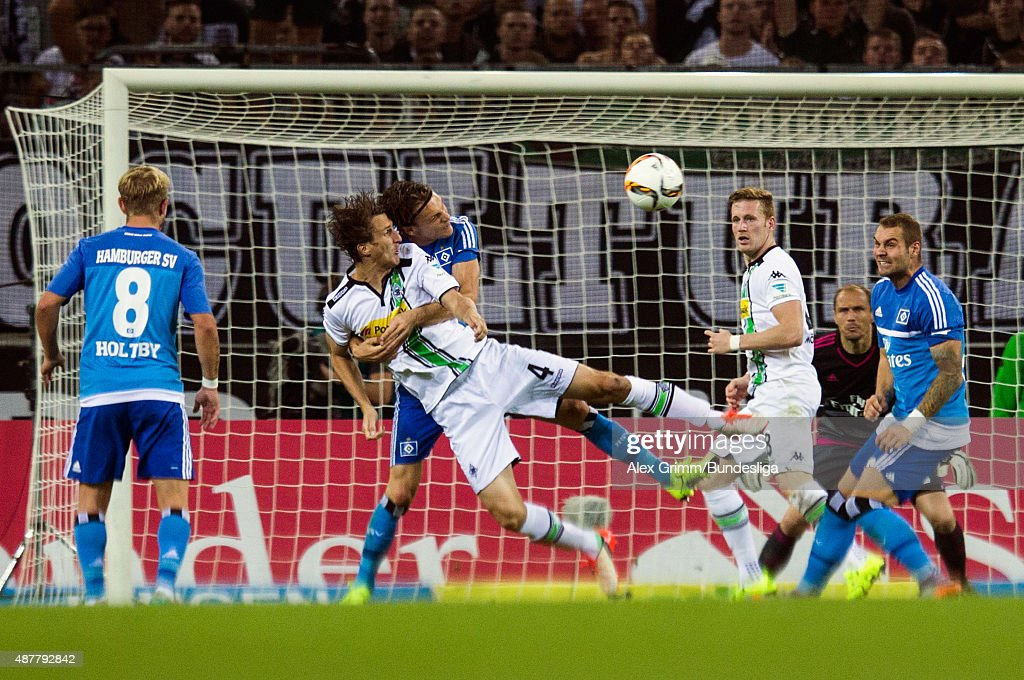 Roel Brouwers (front) of Moenchengladbach is challenged by Albin Ekdal of Hamburg during the Bundesliga match between Borussia Moenchengladbach and Hamburger SV at Borussia-Park on September 11, 2015 in Moenchengladbach, Germany.
