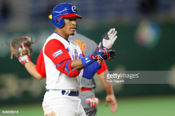 Roel Santos of Team Cuba reacts after hitting a tworun triple in the fourth inning during Game 2 of Pool B against Team China at the Tokyo Dome on...
