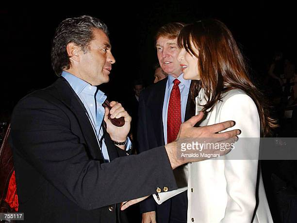 Roffredo Gaetani Donald Trump and his girlfriend Melania Knauss attend the Luca Luca Fashion Show February 12 2002 in New York City