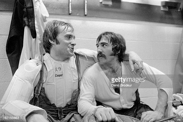 Rogatien Vachon and Ken Dryden of the Montreal Canadiens have a conversation in the locker room at the Montreal Forum circa 1971 in Montreal Quebec...