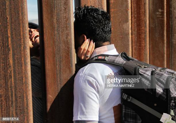 TOPSHOT Rogelio and Miriam embrace through the border wall between Mexico and the United States as they get married during the 'Keep our dream alive'...