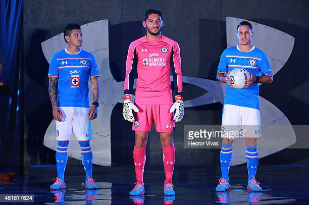 Rogelio Chavez Jesus Corona and Christian Gimenez of Cruz Azul pose for pictures during the presentation of the new kit at Club Deportivo La Noria on...